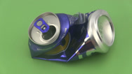 Stock Video Footage of Crushed drinks can on a green background.