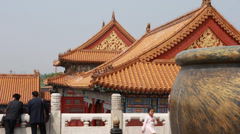 Tourists viewing amazing forbidden city in courtyard beijing china Stock Footage