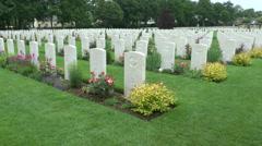 Headstones in the CWGC Ranville War Cemetery, Ranville, Calvados, France. Stock Footage