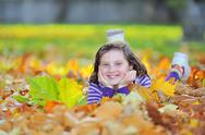 Stock Photo of little girl on autumn