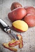 Ecological peeled potatoes Stock Photos
