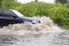 vehicle in flood - stock photo