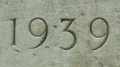 1939-1945 on a wall of a Commonwealth Cemetery, Ranville, Calvados, France. Stock Footage