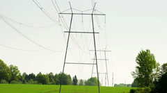 two big electric posts with wires - stock footage