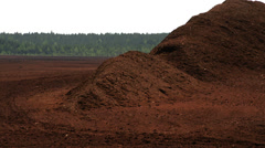 Big heaps of red peat land Stock Footage
