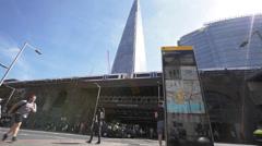 UK Police Van Paddie Wagon London bridge, Black Cabs, The Shard and commuters - stock footage