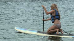 Paddleboard girl - stock footage