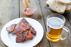 Spareribs on grill with hot marinade, czech beer Stock Photos
