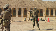 Marines instruct afghan army at firing range (HD) Stock Footage