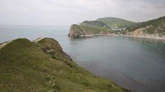 PAN of Lulworth Cove Dorset England UK Stock Footage