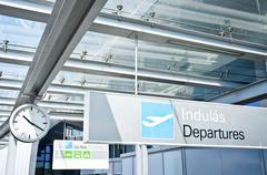 Departure sign at airport with airplane Stock Photos
