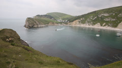Boast in Lulworth Cove harbour Dorset England UK Stock Footage