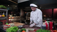 Cook in white uniform making sushi rolls, restaurant kitchen Stock Footage