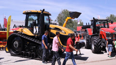 Modern agricultural  Tractor in the  fair  Stock Footage