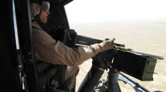 Helicopter door gunner unjams machine gun (HD) Stock Footage