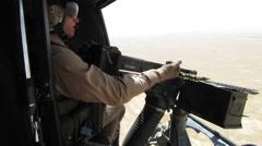 helicopter door gunner unjams machine gun (HD) - stock footage