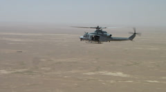 marine huey helicopter flying over afghanistan desert (HD) - stock footage
