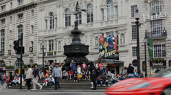 London Tourists, Statue of Eros, Piccadilly Circus, London - stock footage