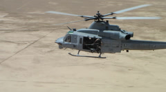 Stock Video Footage of marine huey helicopter flying over afghanistan desert (HD)
