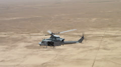 Stock Video Footage of high angle view of marine huey helicopter over afghanistan desert (HD)