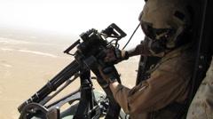 helicopter door gunner attempts to unjam machine gun (HD) - stock footage