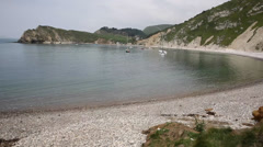 Lulworth Cove Dorset with boats in the natural harbour Stock Footage