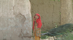 small afghan in ethnic clothing waves at camera  (HD) - stock footage
