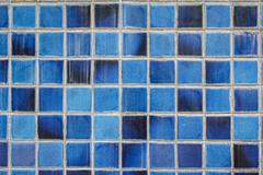 blue ceramic wall tiles and details of surface - stock photo