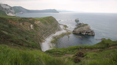 Mupe Bay rocks east of Lulworth Cove Dorset England Stock Footage