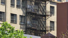 4K Typical New York Style Apartment Building Fire Escape Establishing Shot Stock Footage