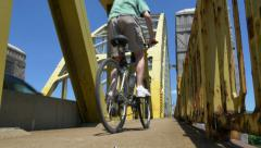 4K Man Rides Bike on West End Bridge - stock footage