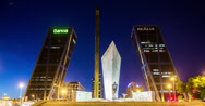 Stock Video Footage of 4K Time lapse of the Puerta de Europa and Caja Madrid Obelisk, in Madrid Spain