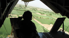 US Marine sits in open rear doorway of helicopter WAR in afghanistan Stock Footage