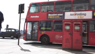 Stock Video Footage of Royal Mail, A Red Bus Passes by a mailbox in London United Kingdom