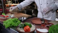 Restaurant cook  presenting delicious sushi maki on a plate Stock Footage