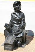 sculpture shoeshine at the main pedestrian historical street bolshaya pokrovs - stock photo