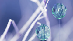 Beautiful festive shiny beads hanging, Macro Stock Footage