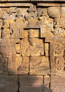 bass-relief on the wall in borobudur temple - stock photo