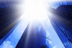 Skyscrapers and sun glare Stock Photos