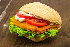 fish bun with tomato salad and remoulade - stock photo
