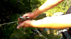 Hands are preparing climber rope into eight device for climbing up to rock Stock Footage