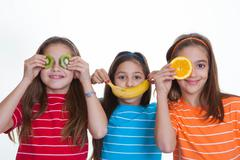 Stock Photo of kids with healthy diet of fruit.