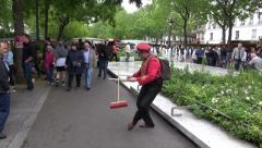 Juggler performer street show with broom, MAY 25, 2014 in Paris, France Stock Footage