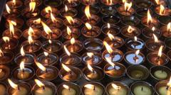 Burning candles in Buddhist temple, Katmandu Stock Footage