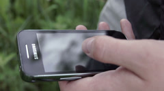 Smartphone in the hands of a young man Stock Footage