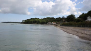 Stock Video Footage of Seagrove Bay near Bembridge and St Helens harbour Isle of Wight England