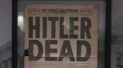 """HITLER DEAD"" headline, Mémorial de Caen Museum, Normandy, France. Stock Footage"