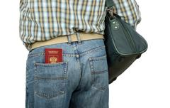 Stock Photo of passenger holding russian passport in rear pocket