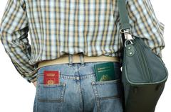 Stock Photo of passenger holding tonga and russian passports in rear pockets