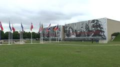 Flags flying outside the Mémorial de Caen (Caen Memorial), Normandy, France. Stock Footage
